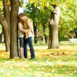 Outdoor autumn portrait of happy young couple — Foto de Stock