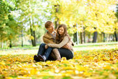 Dating couple in yellow leaves on a fall day — Stock Photo
