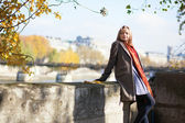 Parisian girl on the embankment on a fall day — Stock Photo