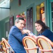 Happy smiling couple in an outdoor cafe — Stock Photo #27134695
