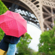 Couple in Paris kissing under the rain — Stock Photo