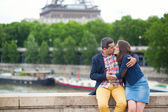 Romantic couple kissing near the Eiffel tower — Stock Photo