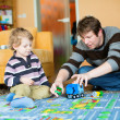 Father and son playing together at home — Stock Photo