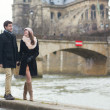 Couple walking near the Notre-Dame in Paris — Foto de Stock