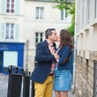 Couple kissing on the street — Stock Photo