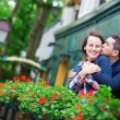 Couple on balcony with blossoming geranium — Stock Photo