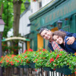 Couple on balcony with blossoming geranium — Foto de Stock