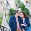 Beautiful couple on the stairs of Montmarte — Stock Photo