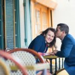 Couple kissing in an outdoor cafe — Stock Photo #28174837