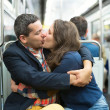 Couple kissing in the Parisian metro — Stock Photo