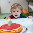 Little boy with birthday cake — Stock Photo