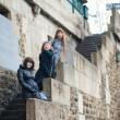 Three girls on the Seine embankment — Stock Photo