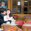 Loving couple in a Parisian cafe — Stock Photo