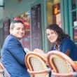 Cheerful couple in an outdoor cafe — Stock Photo