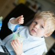 Stock Photo: Adorable little boy eating yoghurt
