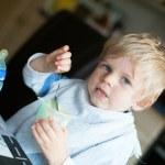 Adorable little boy eating yoghurt — Stock Photo