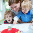 2-year boy celebrating birthday with family — Stock Photo