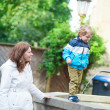 Mother and son walking together — Stock Photo