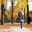Girl walking on a beautiful fall day — Stock Photo