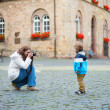 Stock Photo: Mother taking picture of her son