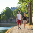 Stock Photo: Romantic couple walking near Seine