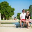 Couple of tourists in Tuileries garden — Stock Photo #29664399