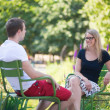 Couple relaxing in Tuileries garden of Paris — Stock Photo #29664671