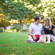 Couple relaxing on the grass — Foto de Stock