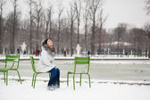 Young woman in Tuileries garden on a winter day — Stock Photo