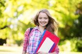 Student girl going back to school and smiling — Stock Photo