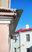 Decorative boot-shaped drainpipe in Tallinn — Stock Photo