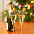 Champagne and Christmas tree — Stock Photo