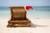 Santa hat on chaise longue — Stock Photo