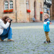 Mother taking picture of her son — Stock Photo