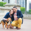 Couple with a dog  — Stock Photo