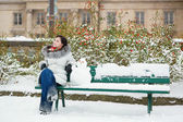 Girl with snowman — Stock Photo