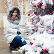 Girl with a Christmas tree — Stock Photo