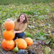 Girl on a pumpkin patch — Stock Photo #32847501