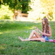Girl on a picnic in park — Stock Photo #32854745