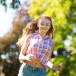 Girl running outdoors — Stock Photo