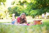 Girl writing in her diary — Stock Photo