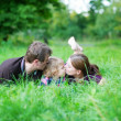 Family of three outdoors — Stock Photo