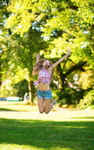 Girl jumping in park — Stock Photo