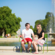 Dating couple in Tuileries garden of Paris — Stock Photo #33716247