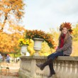 Cheerful girl enjoying a fall day — Stock Photo