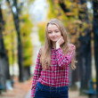 Pretty young girl in a fall park — Stock Photo
