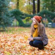 Girl in a park on a fall day — Stock Photo
