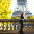 Beautiful young woman in Paris on a fall day — Stock Photo #35948629