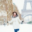 Girl happily jumping in Paris on a winter day — Stock Photo #35978237