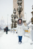 Beautiful young woman in Paris on a snowy day — Stock Photo
